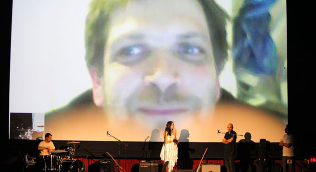 photo of video chat on big screen